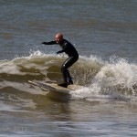 Paul Blackley on his ten foot longboard