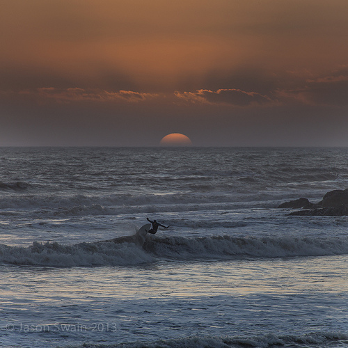 One last wave before the sun goes down at Freshwater Bay.